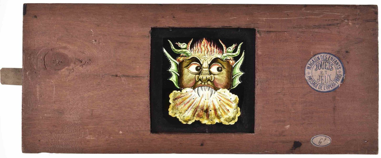 Plaque fantasmagorie, Tête de monstre aux yeux mouvants